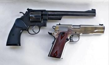 .357 Magnum revolver above a .38 Super 1911 pistol