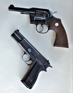 .38 Special Colt Revolver above a black 9mm 1911 pistol