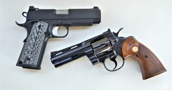 .45 ACP 1911 Commander above, 357 Magnum revolver below