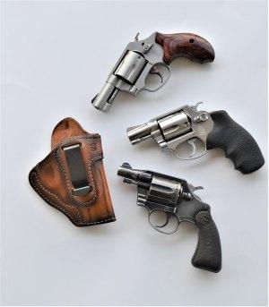 Three snub nose .38 Special pistols