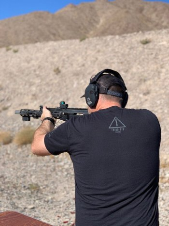 man shooting a Dissident Arms AK-47 at Red Oktober in Las Vegas Nevada