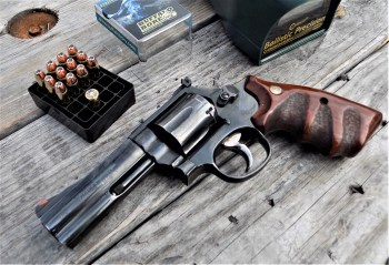 S&W 686 revolver on a wood bench