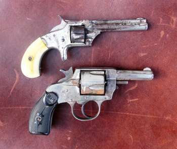 Two early model Smith and Wesson revolvers