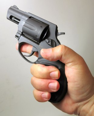 hand holding the Taurus Model 856 revolver in the air