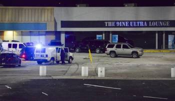 police scene of armed good guys outside the Kansas City's 9ine bar