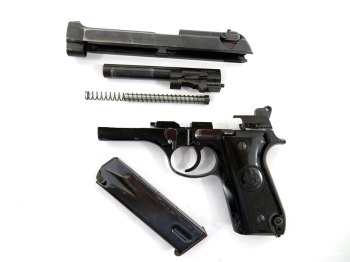 Field stripped Beretta 92S pistol left profile