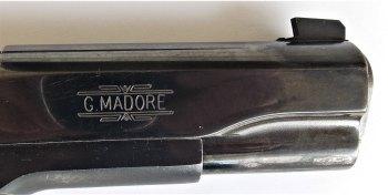 GI 1911 handgun slide with Madore seal