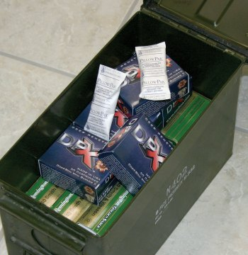 Ammo can packed with boxes of handgun ammunition and descant packs