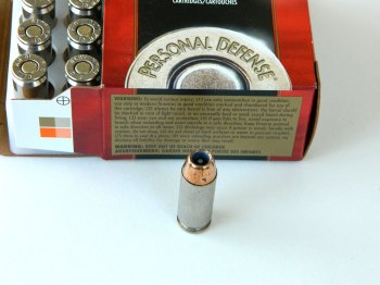 open box of Federal Hydra-Shok ammunition with one loose cartridge