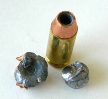 Double Tap 10mm cartridge showing a 135-grain JHP bullet over a 95-grain lead ball