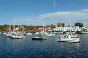 Pleasure boats bob on their moorings in the beautiful harbor of Camden, Maine.