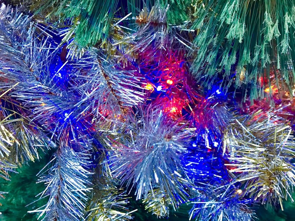 Tinsel and lights galore. This photo was shot in pure daylight last season. As you can see, the lights don't stand out as much as they should. The focus is more on the tinsel on the tree.