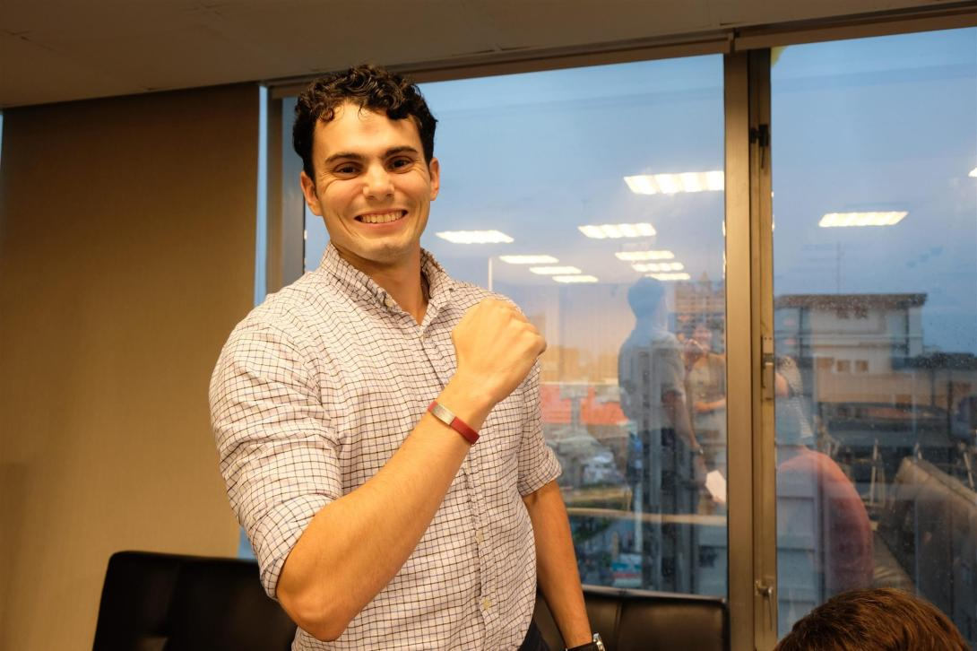 "Joey is showing off his new medical alert bracelet, which says ""食物過敏,"" or ""Food Allergy"" in Mandarin."