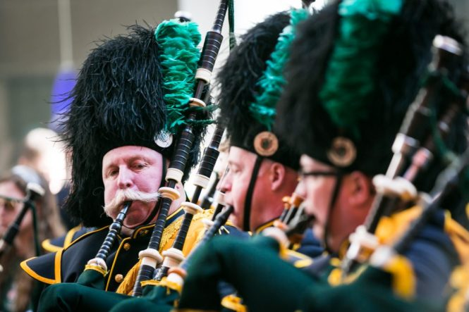 Bagpipe players at the 2016 St. Patrick's Day Parade in NYC by photojournalist, Kelly Williams