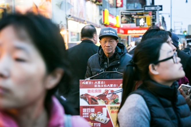 Sign board man in Flushing Queens street photography series