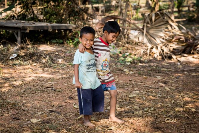 Two boys walking for an Angkor Wat temple guide
