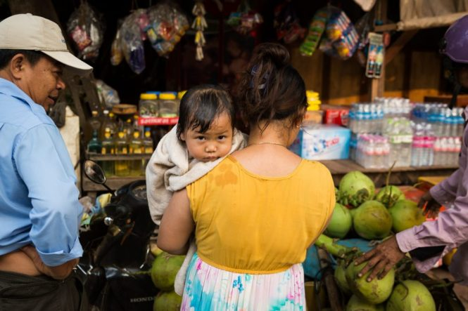 Baby on mother's shoulder for an article on Siem Reap travel tips