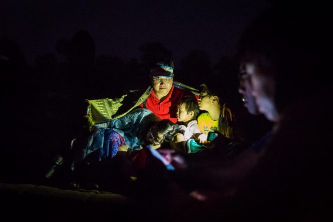 Family lit by flashlight for an article on Angkor Wat sunrise strategies