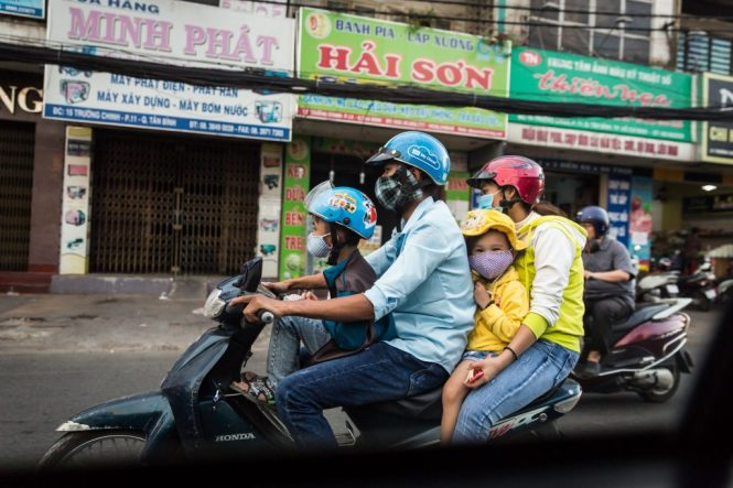 Family on a motorcycle for article on Ho Chi Minh City street photos