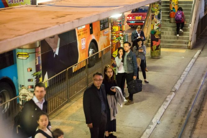 People waiting at ding ding station for a Hong Kong street photography series called the view from the ding ding