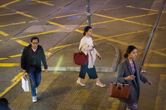People crossing the street for a Hong Kong street photography series called the view from the ding ding