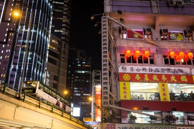Subway train and Hong Kong city skyline for a Hong Kong travel guide article
