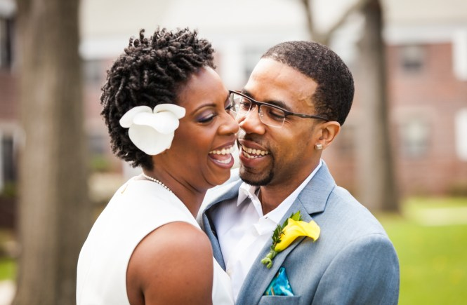 Wedding portrait of African American couple in Flushing Meadows Corona Park