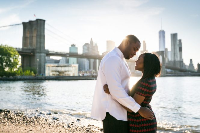 Couple hugging at Brooklyn Bridge Park for an article on best engagement photos