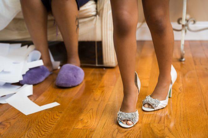 Little girl wearing mom's high heels at a Glen Terrace wedding