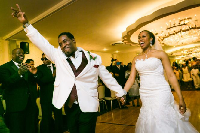 Bride and groom entering the reception at a Glen Terrace wedding