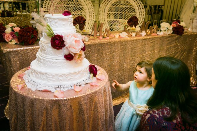 Little girl pointing to wedding cake at a Glen Terrace wedding