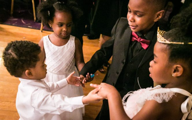 Little kids dancing together at a Glen Terrace wedding