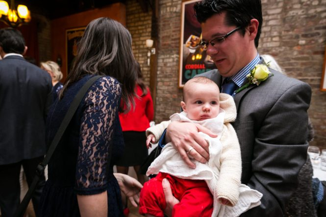 Guest and baby waiting for a Scottadito wedding