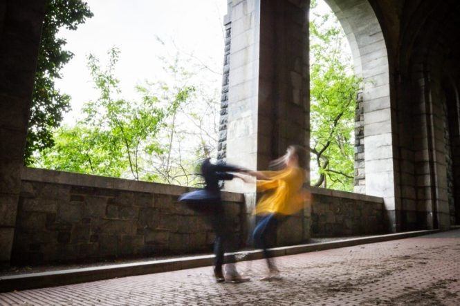 Twirling couple at a Fort Tryon Park engagement portrait