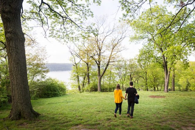 Couple walking at a Fort Tryon Park engagement portrait