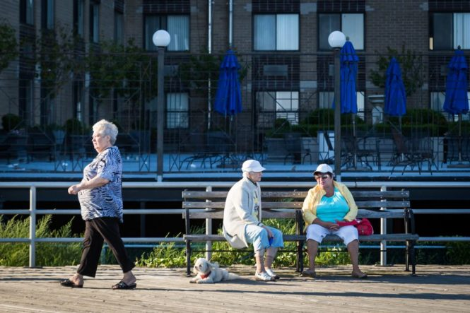 Three older women on the Coney Island boardwalk