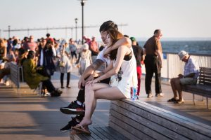 Lovers on a bench at the Coney Island pier