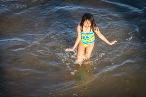 Girl in the ocean at Coney Island