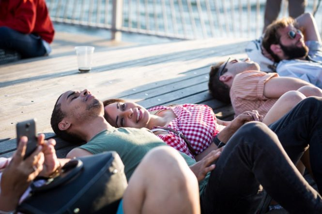 Lovers lounging on the Coney Island pier