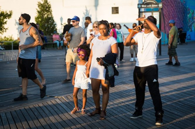 Mother and child wearing sunglasses on the Coney Island boardwalk