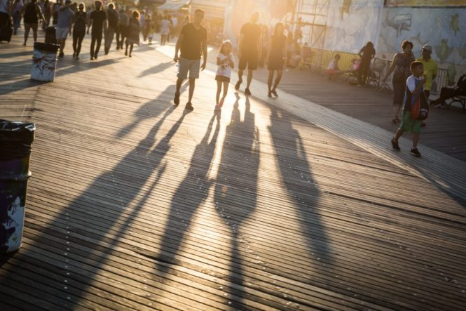 Shadows of tourists on the Coney Island boardwalk