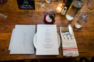Place setting at a rehearsal dinner for an article on details your wedding photographer needs to know