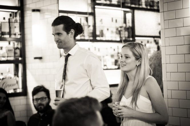 Bride and groom at a rehearsal dinner for an article on details your wedding photographer needs to know