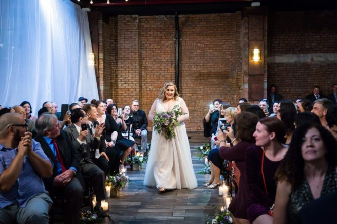 Bride coming down the aisle at a 26 Bridge wedding