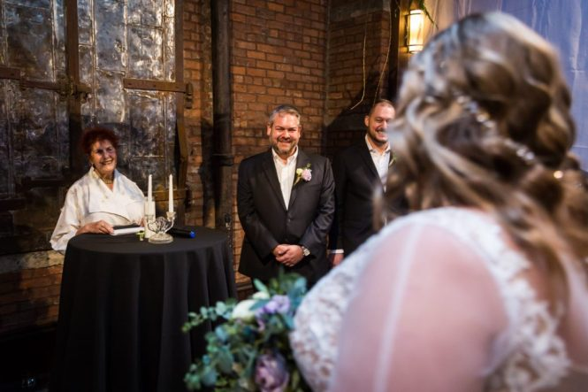Groom seeing bride for the first time at a 26 Bridge wedding