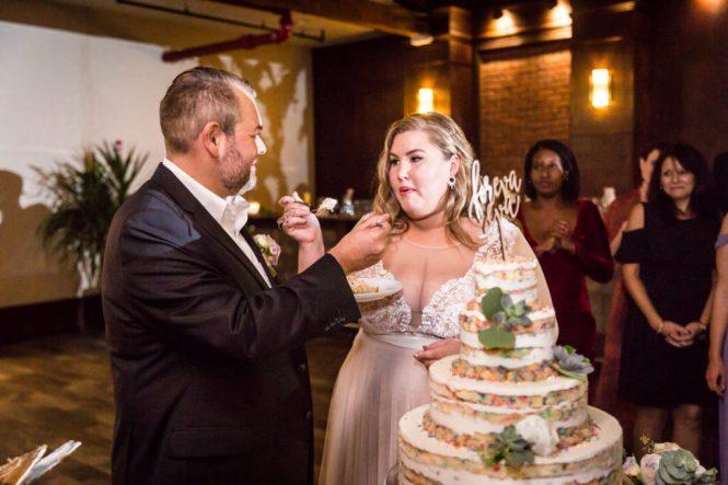 Cake cutting at a 26 Bridge wedding