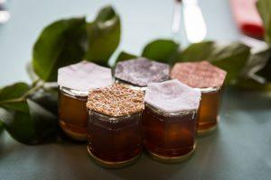 Honey jar guest favors at a Bear Mountain Carousel wedding