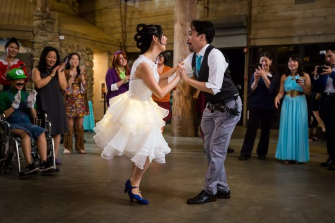 Bride and groom swing dancing at a Bear Mountain Carousel wedding