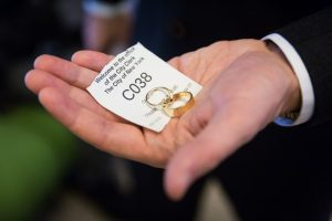 Ticket number and wedding rings for an article on How to Get Married at City Hall in Any NYC Borough