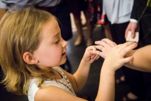 Flower girl looking at bride's ring for an article on How to Get Married at City Hall in Any NYC Borough